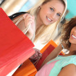 Girls in shopping frenzy — Stock Photo