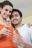 Couple drinking a celebratory drink — Stock Photo