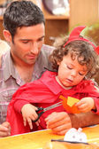 Dad with his child dressed as a devil for Halloween — Stock Photo