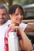 The farmer, his wife and the milk churn — Stock Photo