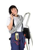 Female electrician making telephone call — Stock Photo