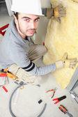 Man padding walls with insulation — Stock Photo
