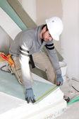 Man installing wall panels — Stock Photo