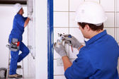 Electricians at work — Stock Photo