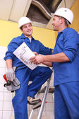 Two electrician repairing ceiling — Stock Photo