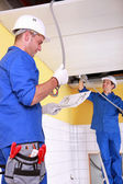 Electricians installing electrical cabling — Stock Photo