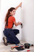 Woman covering an electrical wire — Stock Photo