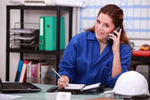 Corporate woman answering phone — Stock Photo