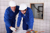 Plumbers at work — Stock Photo
