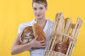 Baker displaying her bread — Stock Photo