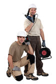Tradesmen posing with their tools — Stock Photo
