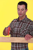 Craftsman cutting a board — Stock Photo