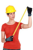 Craftswoman holding a meter — Стоковое фото