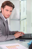 Young businessman on laptop — Stock Photo