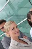 Headshot smart happy workers outside office building — Stock Photo