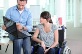 Young woman disabled with co-worker — Stock Photo