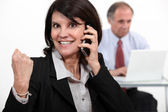 Businesswoman talking on phone and receiving very good news — Stock Photo