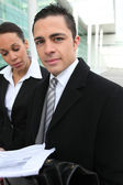Business executives outside an office building — Stock Photo