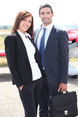 Cheerful couple of businesspeople — Stock Photo