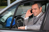 Architect in car using mobile telephone — Stock Photo