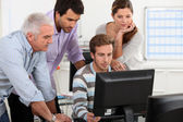 Colleagues looking at computer — Stock Photo