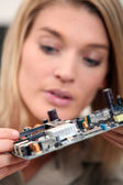 Woman fixing a motherboard — Stock Photo