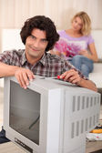 Man fixing an old television — Stock Photo