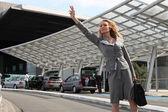 Businesswoman waving taxi — Stock Photo