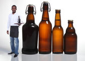 Waiter with beer bottles — Stock Photo