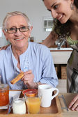 Woman serving breakfast to another woman — Stock Photo