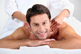 Man enjoying a back massage — Stock Photo