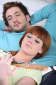 Woman playing the guitar for her boyfriend — Stock Photo