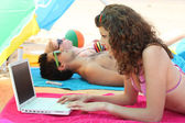 Woman on the beach with laptop — Stock Photo