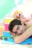 Teenagers lying on the beach — Stock Photo