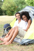 Portrait of a couple in a tent — Stock Photo