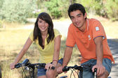 Teenagers doing bike in forest — Stockfoto