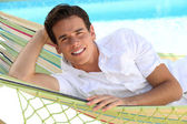 Man laying in hammock — Stock Photo
