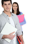 Students holding folders — Stock Photo