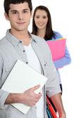 Students holding folders — Stock Photo