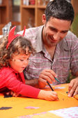Father and son celebrating Halloween — Stock Photo