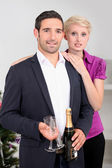 Couple having a glass of wine together — Stockfoto