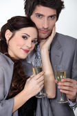 An elegant couple celebrating with a toast — Stock Photo