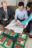 Young couple looking over new house plans — Stock Photo