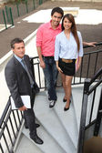 Couple and a real estate agent — Stock Photo