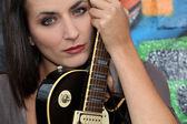Female guitarist — Stock Photo