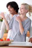 Couple laughing in the kitchen — Stock Photo