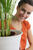 Woman taking care of the plants — Stock Photo