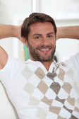 Man alone at home relaxing — Stock Photo