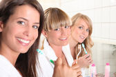 Young woman in the bathroom together — Stock Photo