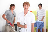 Three lads doing their chores — Stock Photo
